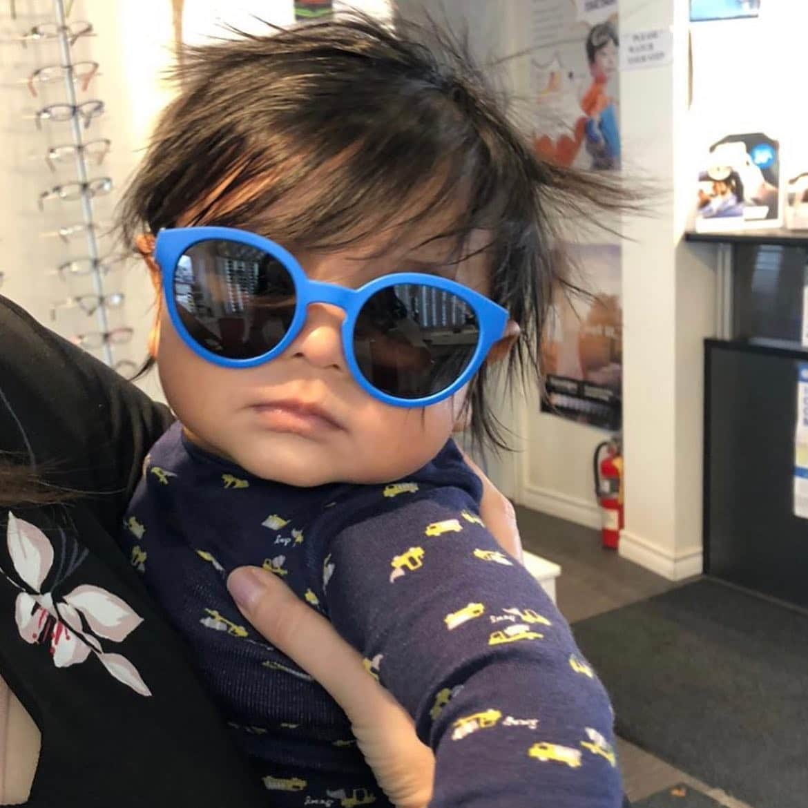 This is Kai, Dr. Vettivelu's son. He is rocking sunglasses at just 4 months of age. You are never too young to protect your eyes from harmful UV light. He made our day when he came to the office to visit us ?#sunglasses #babykai #optometry